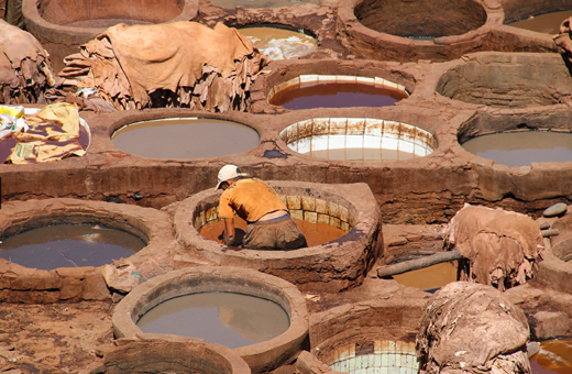 Worker in an open-air tannery