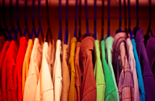 Colourful shirts on hangers
