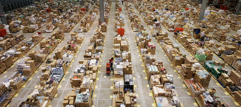 MILTON KEYNES, UNITED KINGDOM - NOVEMBER 17: An Amazon.co.uk employee sorts through books and other retail goods at their facility on November 17, 2006 in Milton Keynes, England. The online retailer is gearing up for the Christmas rush where over a two week period 400,000 units will pass out their doors to British customers. (Photo by Bruno Vincent/Getty Images)